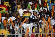 Ghanas national football team supporters cheer their team before the start of the WC2014 African zone qualifier second leg play-off between Egypt and Ghana in Cairo on November 19, 2013. The Ghanaians lead 6-1 after the first leg. AFP PHOTO / KHALED DESOUKI (Photo credit should read KHALED DESOUKI/AFP/Getty Images)